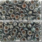 #10.01 - 50 Stück Teacup Beads 2x4 mm - Opaque Turquoise - Bronze Picasso