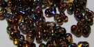 #54.00 - 10 g cz. Farfalle 4x2 mm tr.crystal magic color/orange-
