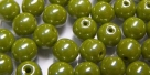 #04.00 25 Stück Perlen rund - opak olivine hem. coating - Ø 6 mm